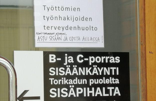 Ovi, josta sisäänkäynti työttömien työnhakijoiden terveydenhuoltoon